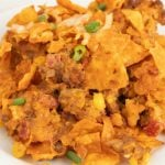 A close up of a plate of food, with Casserole and DORITOS