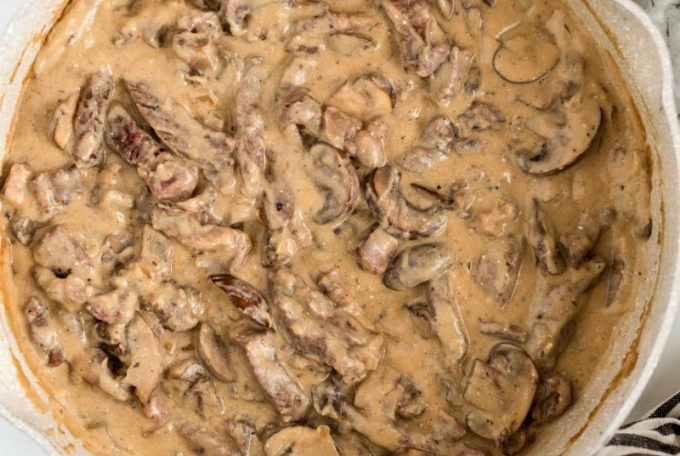 beef stroganoff with mushrooms in a skillet