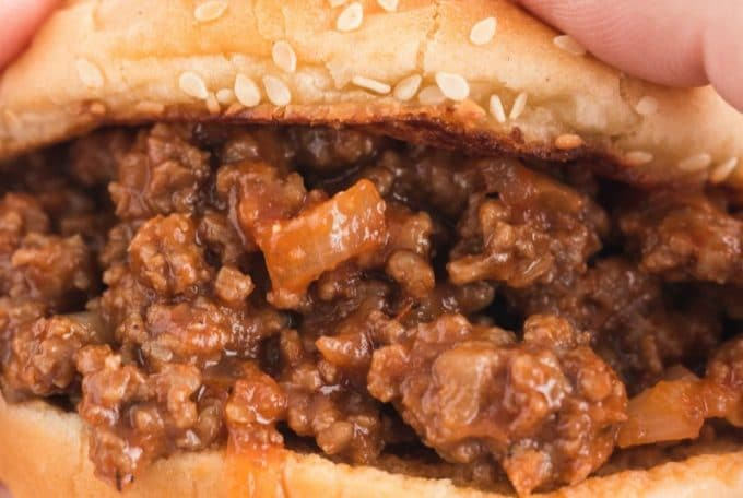 sloppy joe sandwich being held