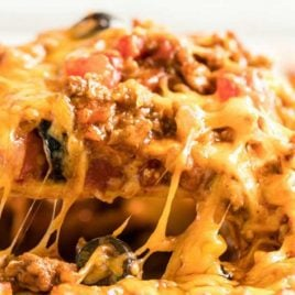 close up shot of taco bake being picked up with a spatula