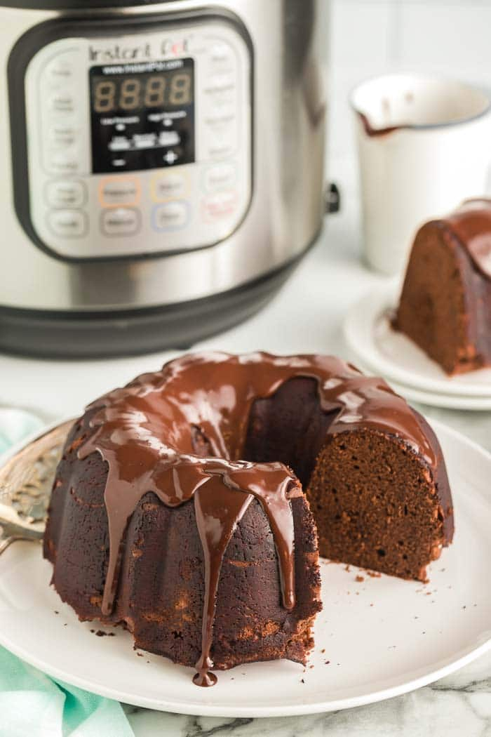CHOCOLATE CAKE IN FRONT OF INSTANT POT