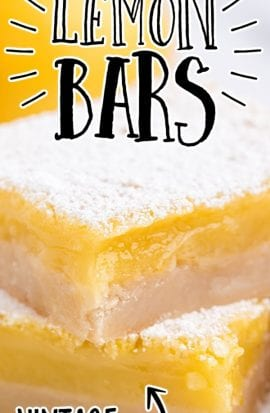 close up side shot of lemon bars stacked on top of each other