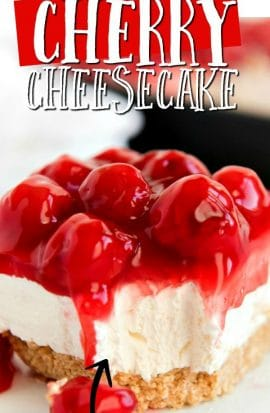 slice of no bake cherry cheesecake with bite gone out of it