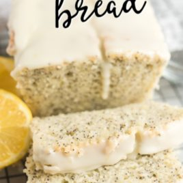 loaf of lemon poppy seed bread with thick slices cut in front
