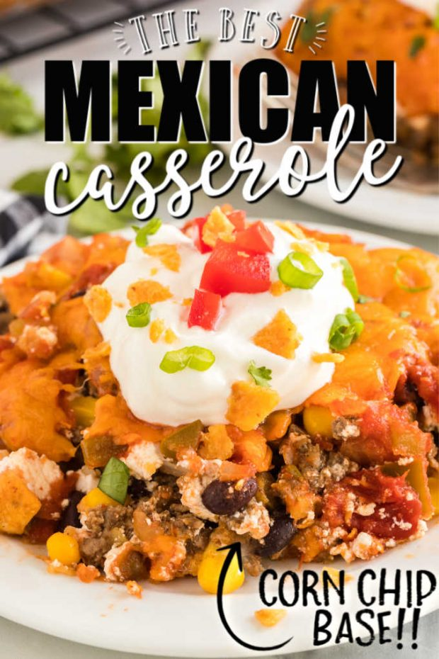 mexican casserole on a plate with sour cream and tomatoes toppings