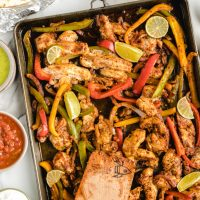 wooden spoon with sheet pan fajitas