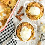 two servings of caramel apple dump cake with baking dish