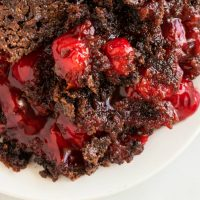 Food on a plate, with Cake and Cherry