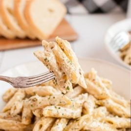 A pile of fries on a plate, with Cream and Garlic
