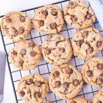 freshly baked gluten free chocolate chip cookies on baking rack