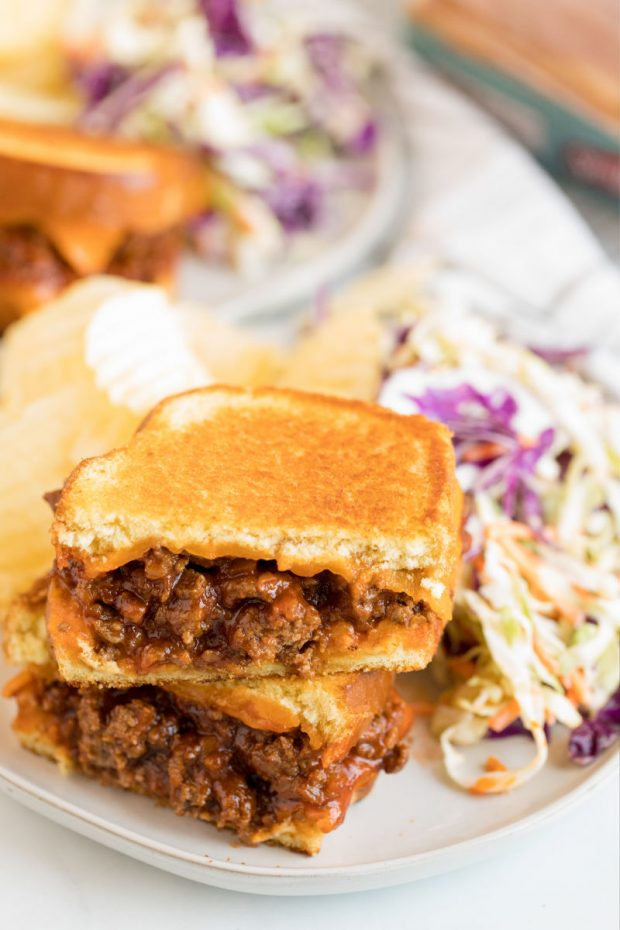 A close up of a sandwich on a plate, with Sloppy joe and Coleslaw