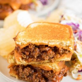A close up of a sandwich on a plate, with Sloppy joe