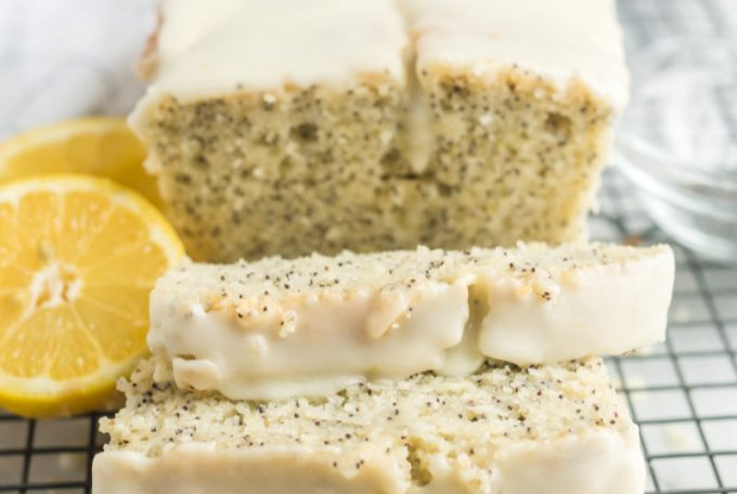 lemon poppy seed bread sliced with loaf behind