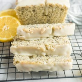 A slice of cake on a plate, with Bread and Poppy seed