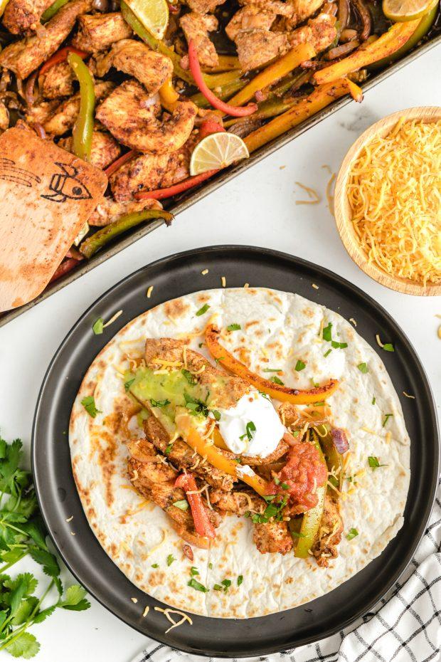 A plate of food, with Fajita and Rice