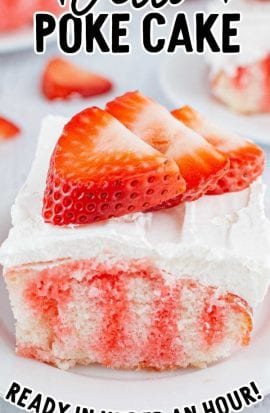 close up shot of a slice of jello poke cake topped with whipped cream and strawberry slices on a plate