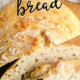 No Knead Bread on cutting board with slices