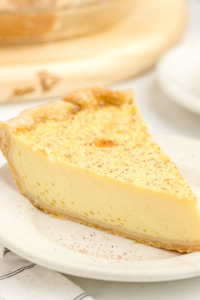 close up shot of custard pie on a white plate