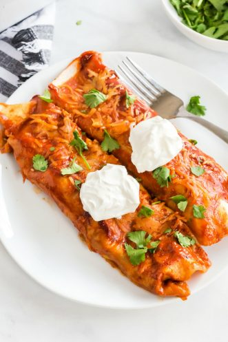 two beef enchiladas on a plate