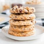 A stack of food on a plate, with Chocolate chip cookie