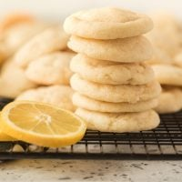 stack of lemon sugar cookies with lemon slice