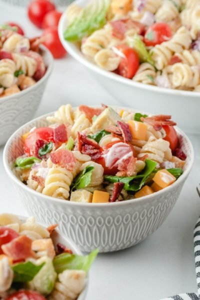 A bowl of salad, with BLT and Pasta