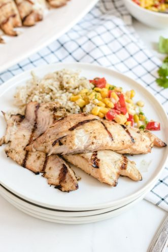 grilled tilapia on plate with rice and corn salsa