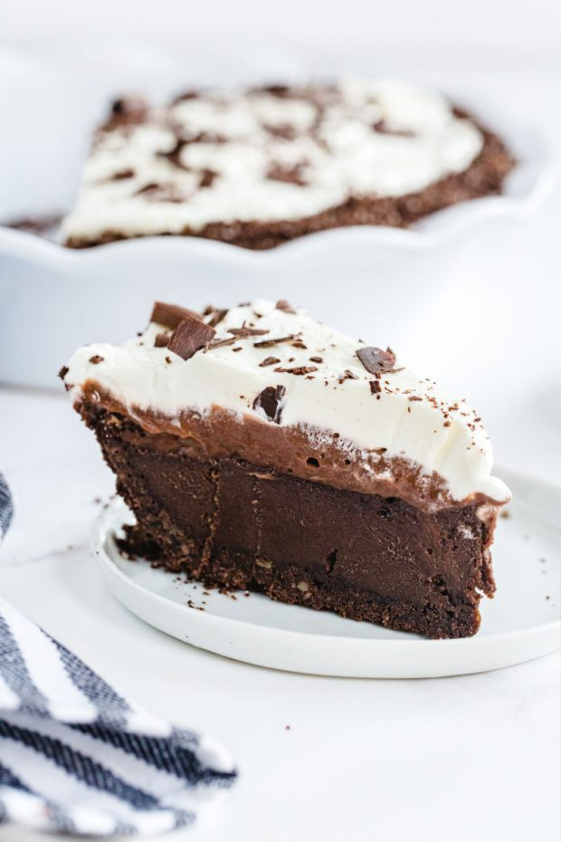 A piece of chocolate cake on a plate, with Mississippi mud pie and Cream