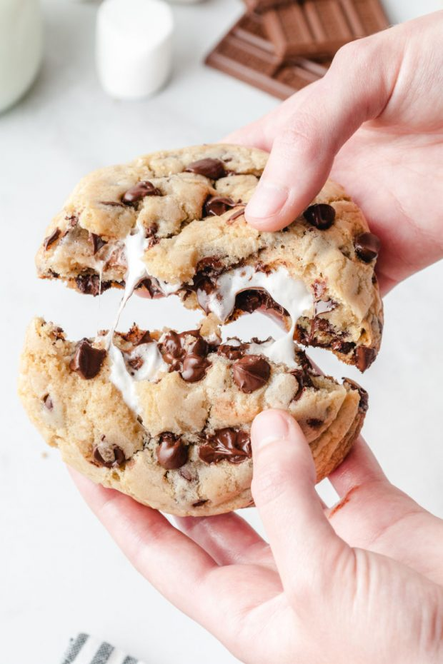 S'mores Stuffed Cookie being pulled apart to reveal marshmallow