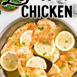 overhead shot of Lemon Chicken with lemon slices and garnished with parsley in a skillet