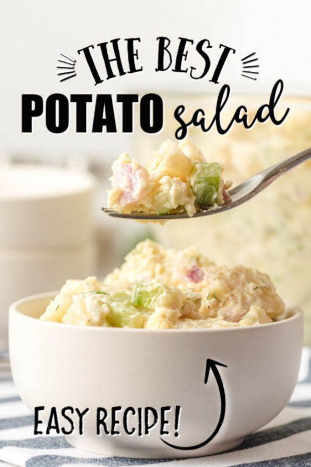 fork holding some potato salad over a spoon