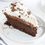 A piece of chocolate cake on a plate, with Mississippi mud pie