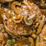 A close up of food, with Salisbury steak
