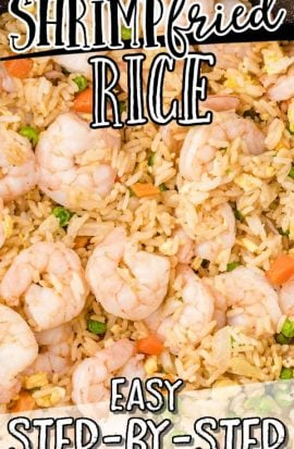 overhead shot of shrimp fried rice in a pan with a wooden spoon