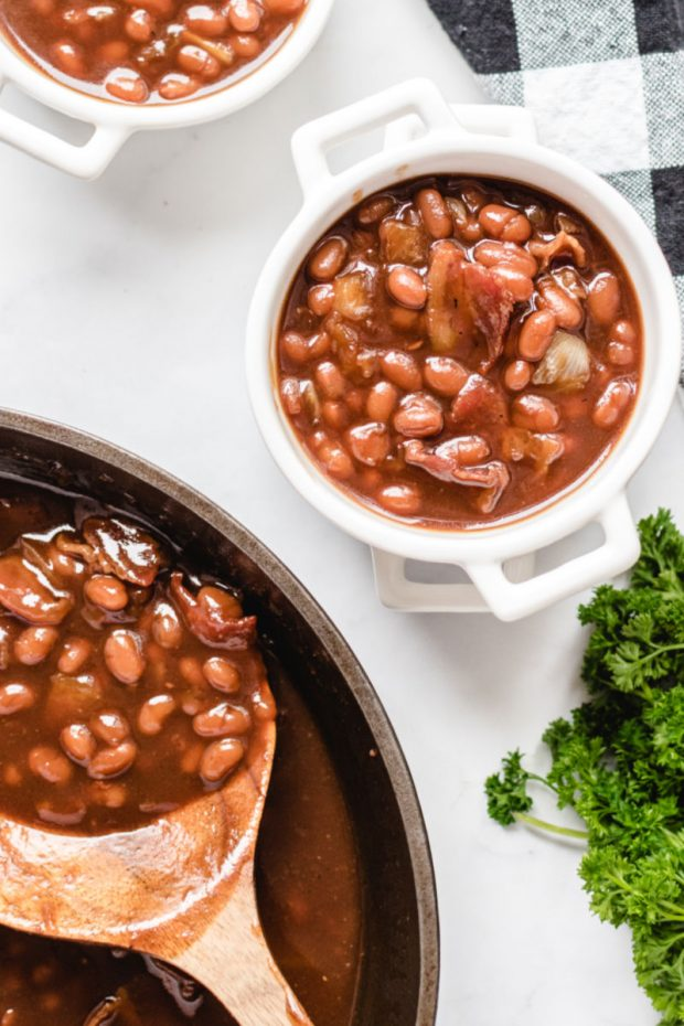 A bowl of food on a table, with Baked beans