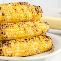 A plate of food, with Corn on the cob