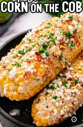 close up shot of Mexican Corn on the Cob topped with parsley