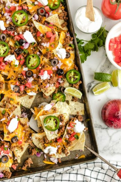 A group of different types of food, with Nachos and Sheet pan