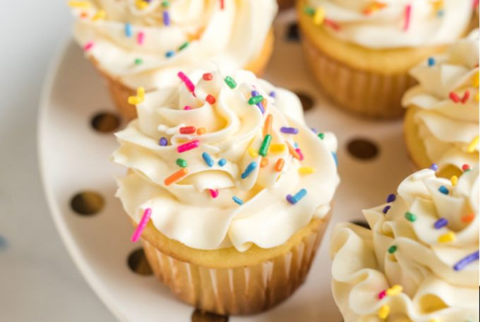 A close up of a cake on a plate, with Cupcake