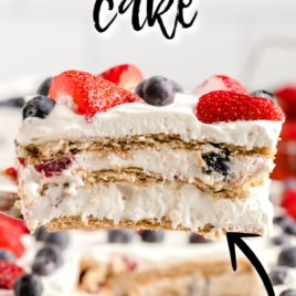 slice of berry icebox cake being lifted from dish