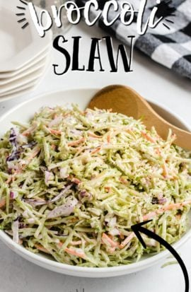 bowl of broccoli slaw with wooden spoon