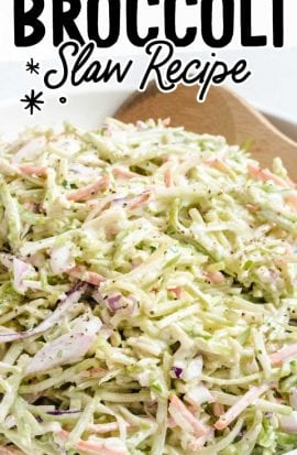 close up shot of broccoli slaw in a bowl with a wooden spoon