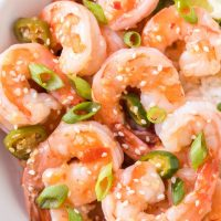 A close up of a plate of shrimp and vegetables, with Garlic