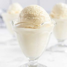 A close up of No Churn Vanilla Ice Cream in a glass cup