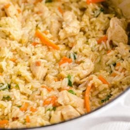 close up shot of one pot chicken and rice in a pan