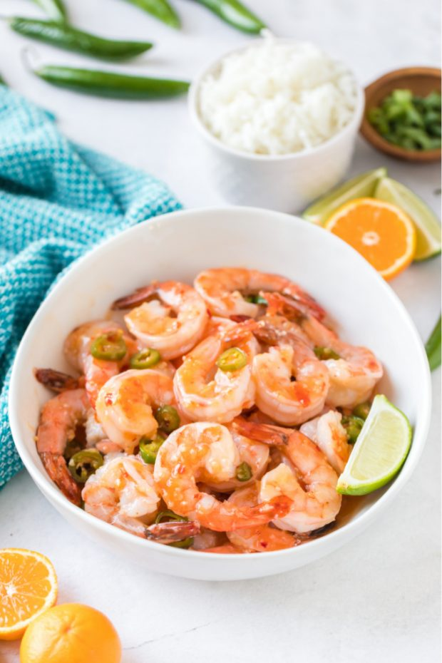 A bowl of food on a plate, with Shrimp and Garlic