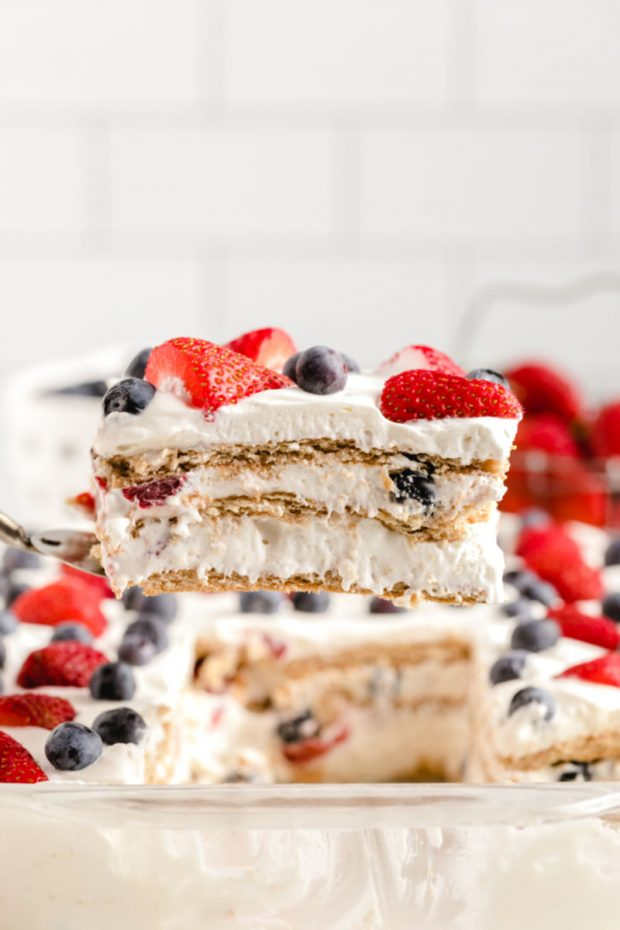 A close up of a slice of cake on a plate, with Berry and Icebox cake