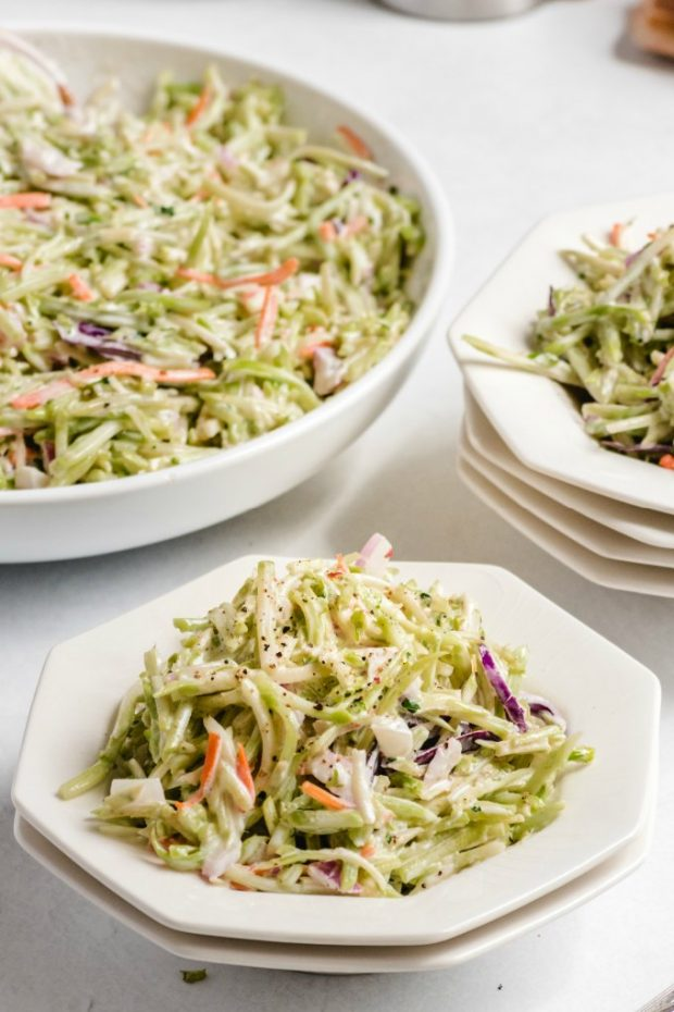 A plate of food on a table, with Broccoli slaw