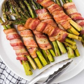 close up overhead shot of bacon wrapped asparagus on a plate