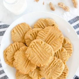 A plate of food on a table, with Cookie and Peanut butter